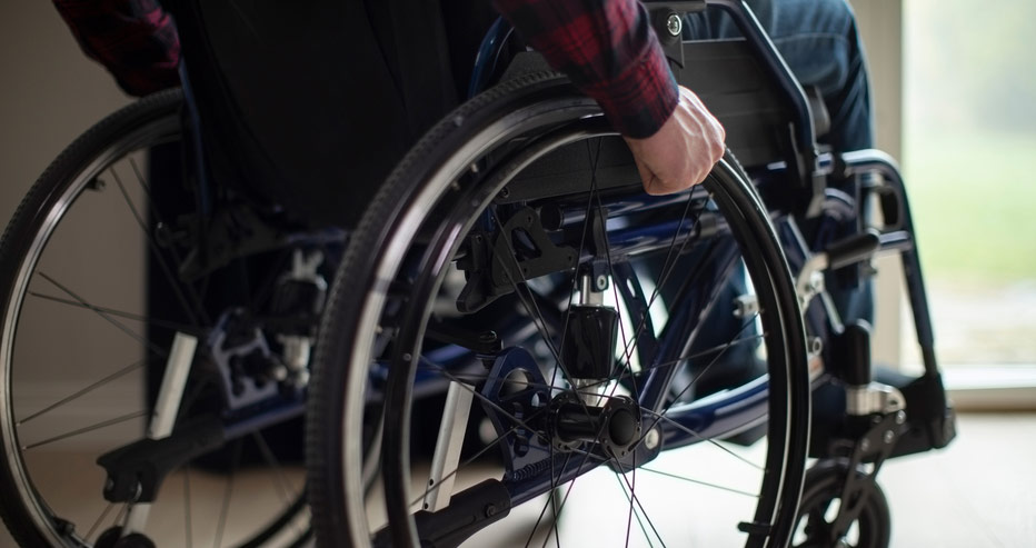 sitting in wheelchair at home